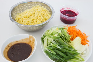 Serves 4 The Japanese equivalent of junk food, this noodle dish is often sold at festivals and as street food, sometimes in a bun. It is quick to make, but to cut down the preparation time further, look out for bottled Yakisoba sauce in an Asian food market.